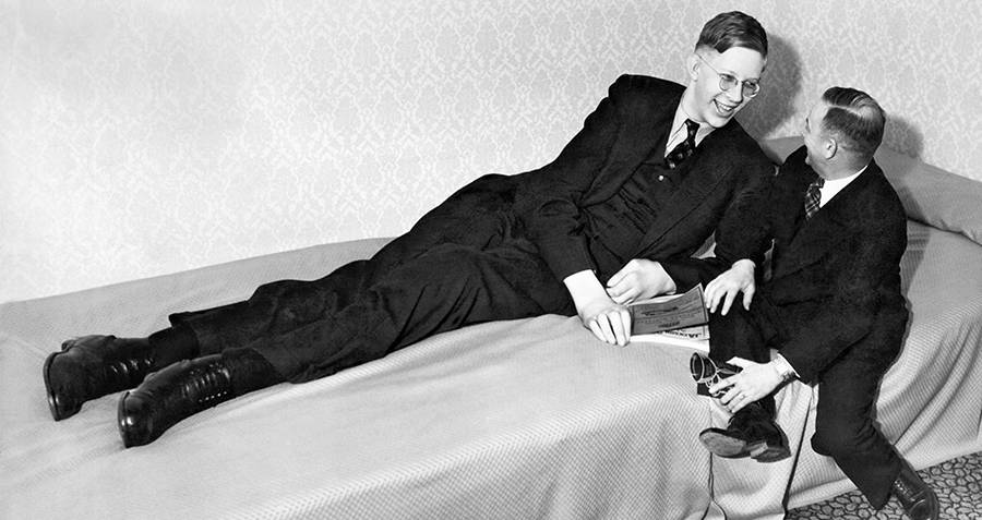 Robert Wadlow Lying Down On A Bed