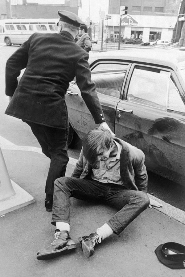 Policeman Arrests Weather Underground Member
