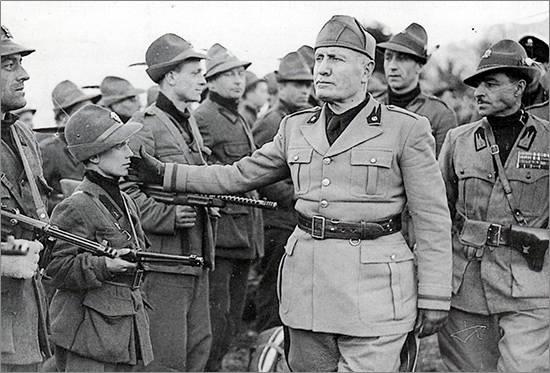 Benito Mussolini taps the cheek boy
